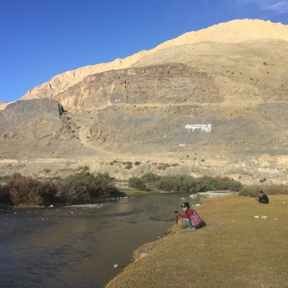 Lazing around Spiti River at Rangrik, note the prayer written on the mountain