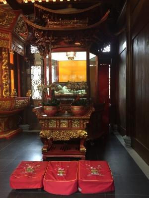 The original reclining Jade Buddha is kept inside a glass casing