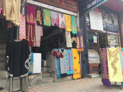 Colourful embroidered shawls and pherans